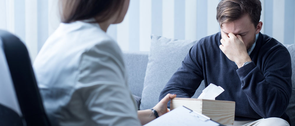 Vancouver Lawyer with Client - Discussing Part 7 / No-Fault Benefits